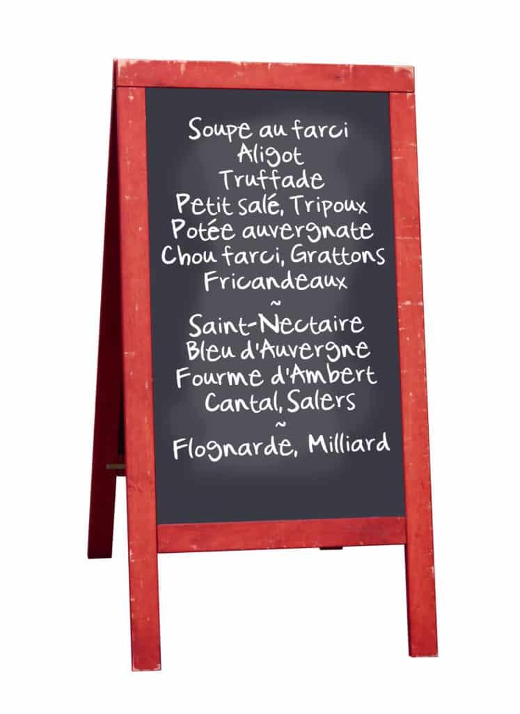 Panneau de restaurant avec les spécialités auvergnate.